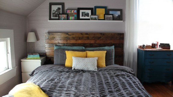 Our colleague Katie Hawkins-Gaar and her husband turned their Ikea Malm bed into a one-of-a-kind masterpiece with the wooden headboard they made. It's the star of the show in their bedroom that balances soothing lavender walls with a dark gray duvet cover.