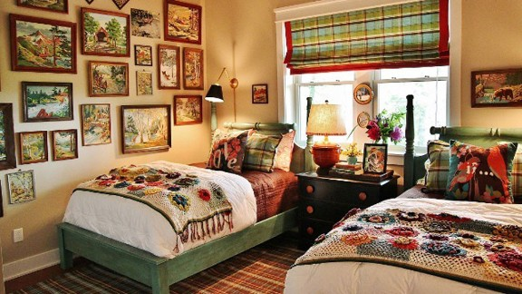 Interior designer Shannon Berrey, who also blogs from the mountains of Sylva, North Carolina, created this cozy vacation home bedroom for her clients who loved paint-by-numbers pictures. She located vintage paint-by-numbers artwork that featured mountain scenes, and drew her color scheme for the bedroom from them.