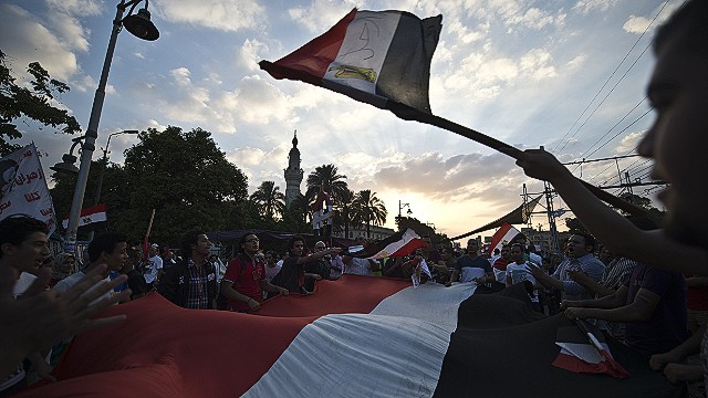 Egyptian demonstrators gather outside the presidential palace in Cairo during a protest calling for the ouster of President Mohamed Morsi on July 1, 2013. Egypt's armed forces warned that it will intervene if the people's demands are not met within 48 hours, after millions took to the streets to demand the president's resignation. AFP PHOTO / KHALED DESOUKIKHALED DESOUKI/AFP/Getty Images