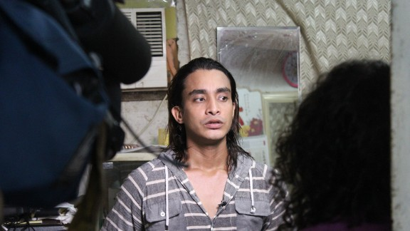 """Arif, a 26-year old refugee from Bangladesh, sits for an interview with CNN reporters in the slum of Ping Che on June 25, 2013. Arif, formerly a pharmacology student and business owner, fled his native country in 2009 when terrorists threatened to kill him. """"I lost everything,"""" he says."""