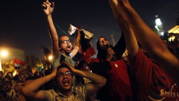 Protesters react after Morsy