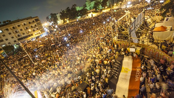 """iReporter<a href=""""http://ireport.cnn.com/people/CouclaRefaat""""> Alia Coucla Refaat</a> captured this image of protesters demonstrating against former President Mohamed Morsy on Tuesday, July 2, on the streets of Cairo. """"The streets are full of chanting and love,"""" she said. """"Men are being respectful to women, giving us our space to take part in this revolution."""""""