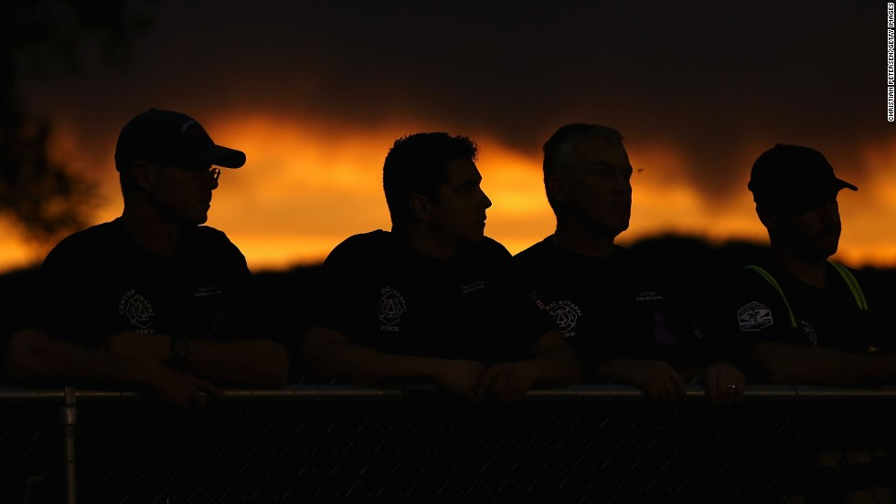 "JULY 2 - PRESCOTT, U.S.: People attend a candle lit vigil in honor of the <a href=""http://cnn.com/interactive/2013/07/us/yarnell-fire/index.html"">19 fallen firefighters</a> who died battling a <a href=""http://cnn.com/2013/07/03/us/arizona-fire/index.html"">fast-moving wildfire</a> near Yarnell, Arizona. The region has been suffering from an extreme drought, and the winds whipping through the mountains can blow embers into new patches of woodland and mesquite grass."
