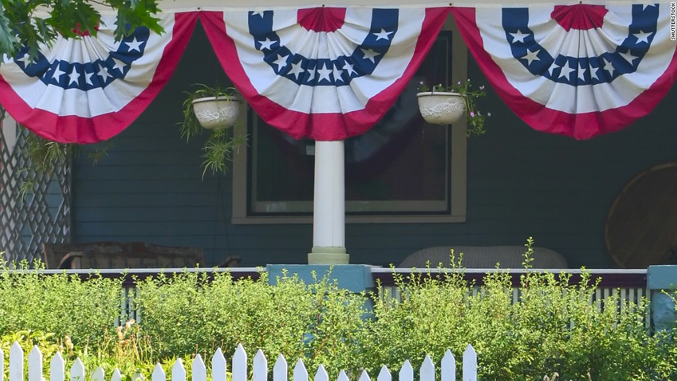 "The Flag Code says the flag should never be ""festooned, drawn back, nor up, in folds, but always allowed to fall free."" Bunting is the preferred method of general flag-related decoration. The Flag code suggests bunting that has blue on the top, white in the middle and red on the bottom."