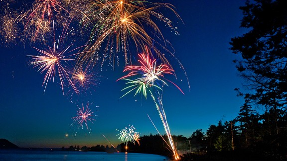 "Edmund Lowe captured this stunning photo over Legoe Bay, Washington, in 2011. ""I never get tired of the Fourth of July,"" he said. ""I have many fond memories of growing up in the '60s, gathering with our neighbors along the street and making it a competition to see who had the most spectacular display."" See his fireworks photo tips in the story below."