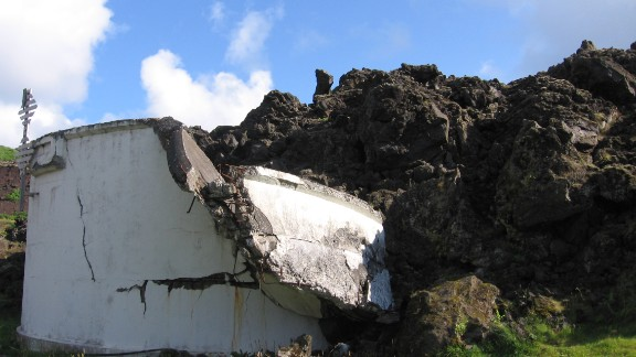 The town of Vestmannaeyjar was saved from Eldfell's lava by using sea-water to stop the flow, but not all structures survived.