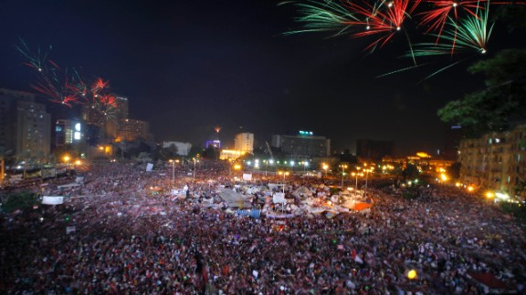 Fireworks light the sky as Morsy opponents celebrate in Tahrir Square on July 3.