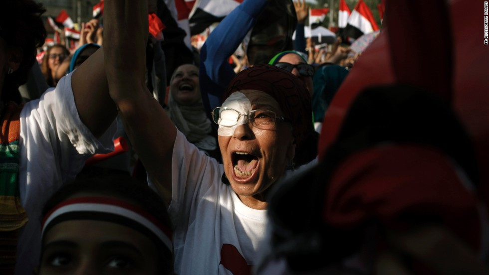 Opposition protesters celebrate outside Egypt's Presidential Palace in Cairo on July 3.