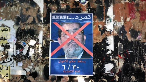 An anti-Morsy poster is displayed on a wall in Tahrir Square on July 3.