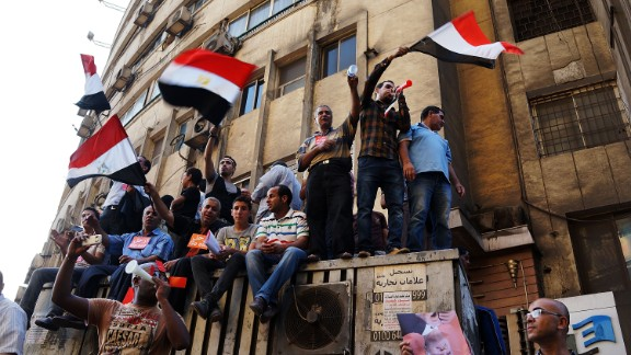 Thousands of Egyptian protesters celebrate in Tahrir Square as the deadline given by the military to Morsy passes on July 3.