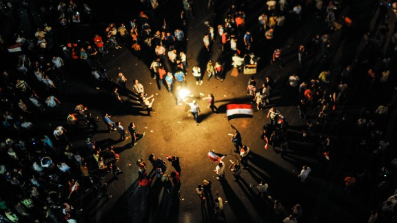 Protesters celebrate near Egypt's Presidential Palace in Cairo on July 3.