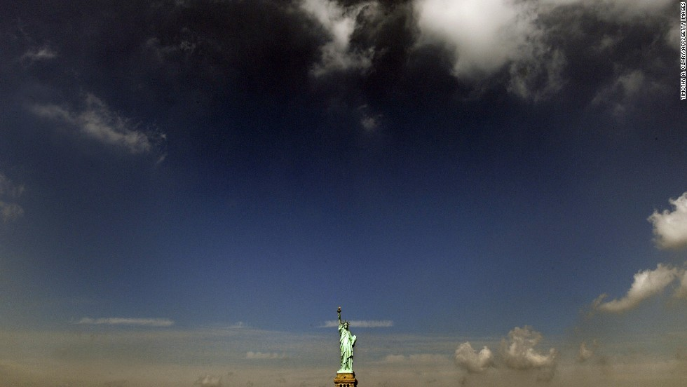 Clouds roll in over the Statue of Liberty in 2008.