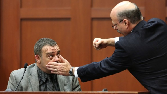Prosecutor Bernie de la Rionda, on July 2, demonstrates a possible scenario while questioning state witness Chris Serino, a Sanford police officer.