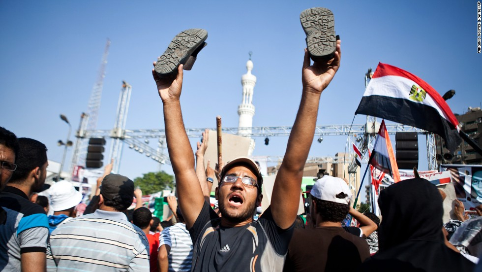 A Morsy supporter reacts as a military helicopter flies over during a July 4 rally in Nasr City.