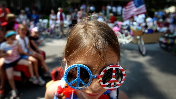 Neeley Mathes, 10, stands in front of the judges on Carr Avenue during the costume contest that follows the annual Central Gardens Fourth of July parade in Memphis, Tennessee.