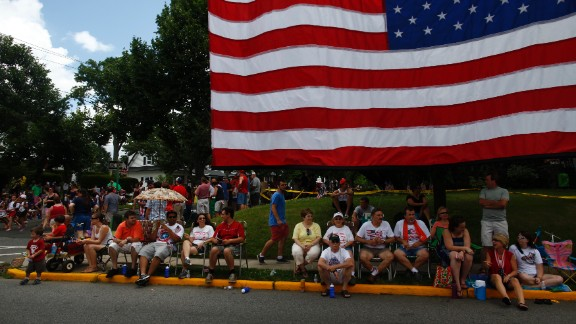 People line the streets to watch a Fourth of July parade in Ridgefield Park, New Jersey.