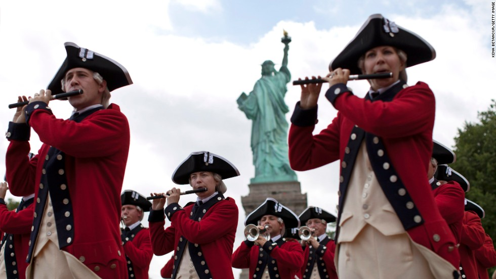 Members of the Old Guard attend the reopening ceremony of the Statue of Liberty, marking the first day it opened to the public after being shuttered by Superstorm Sandy in October.