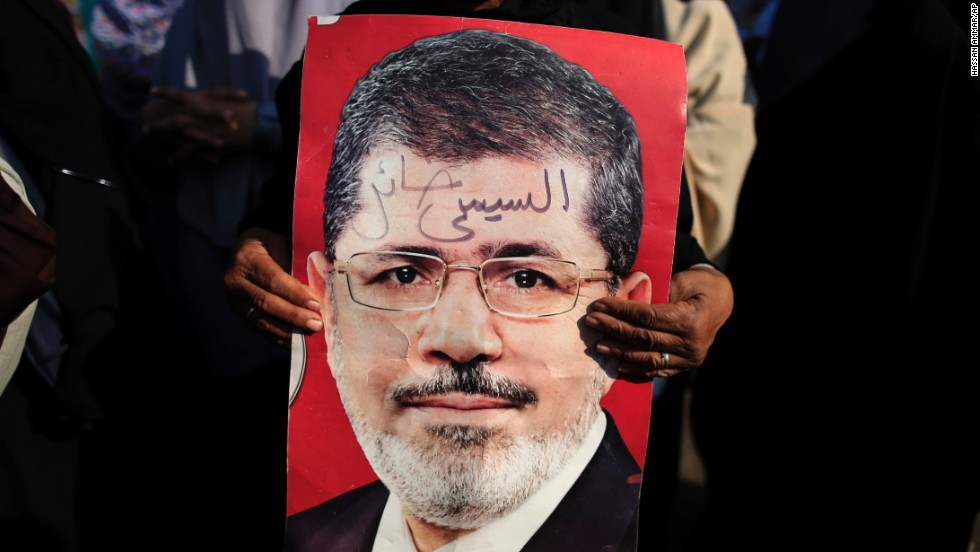 A Morsy supporter holds a poster of the deposed president during a July 4 rally in Nasr City.