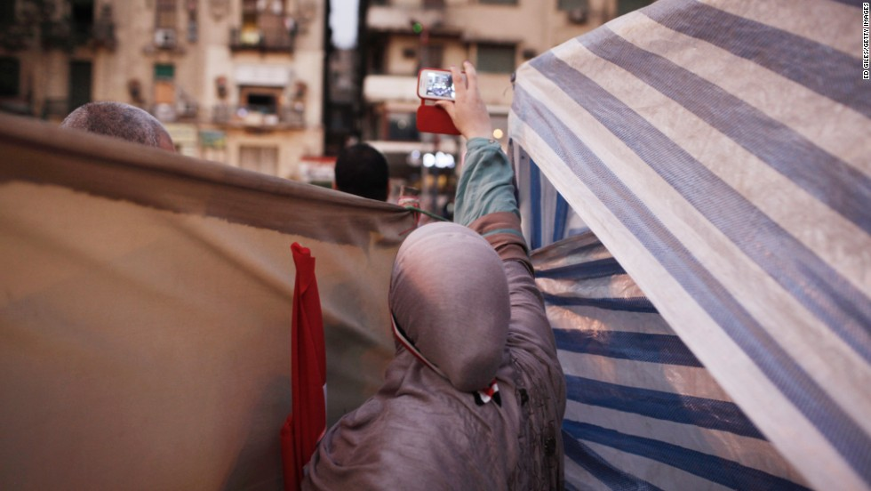 It is easy to repair a smartphone, by virtue of some creative handiwork in markets and souks. But this does not translate to the phones being easily recyclable, however.<br /><br />Pictured: A woman uses a mobile phone to record the July 4 celebrations in Tahrir square, the day after former Egyptian President Mohammed Morsi, the country's first democratically elected president, was ousted from power on July 4, 2013 in Cairo, Egypt.