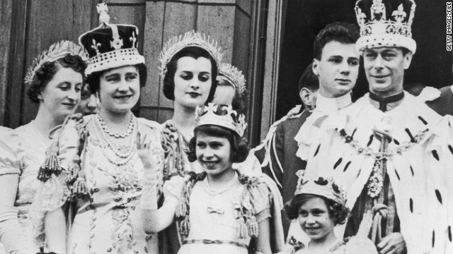The royal family on the balcony at Buckingham Palace September 12, 1937 after the coronation of King George VI. King George VI (R) stands with Princess Elizabeth (C) and Princess Margaret.