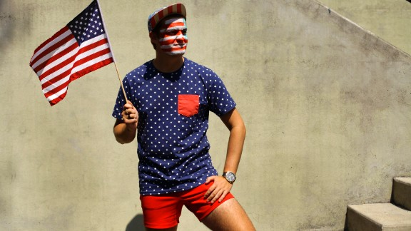 A man displays his patriotic pride while posing for a portrait during Fourth of July celebrations in Prescott, Arizona.