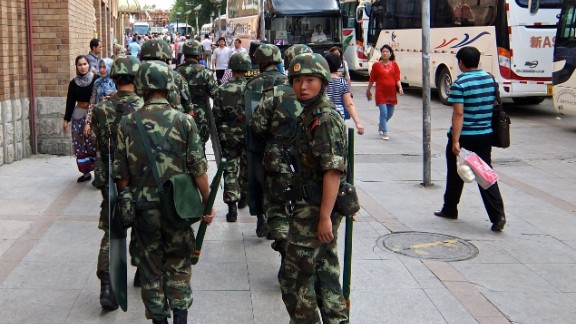 Paramilitary police patrol the streets in the Xinjiang capital earlier this year. .