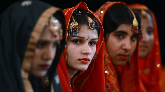 Pakistani brides attend a mass marriage ceremony in Karachi. Some 110 couples participated in the ceremony organized by a local charity welfare trust.