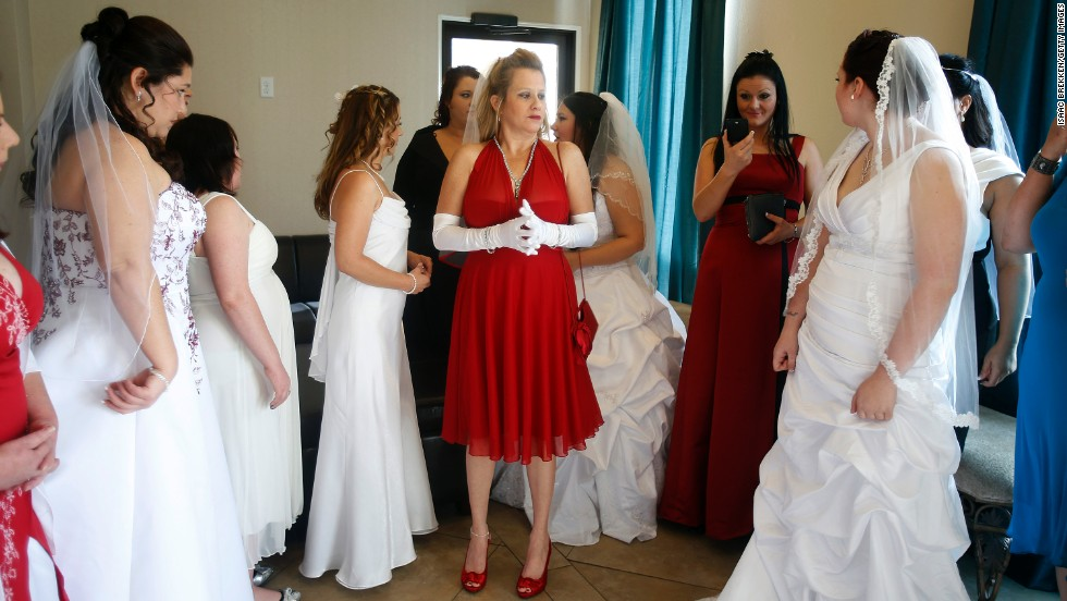 A Dozen Brides Wait To Be Married During Ceremony For Radio Station Contest At