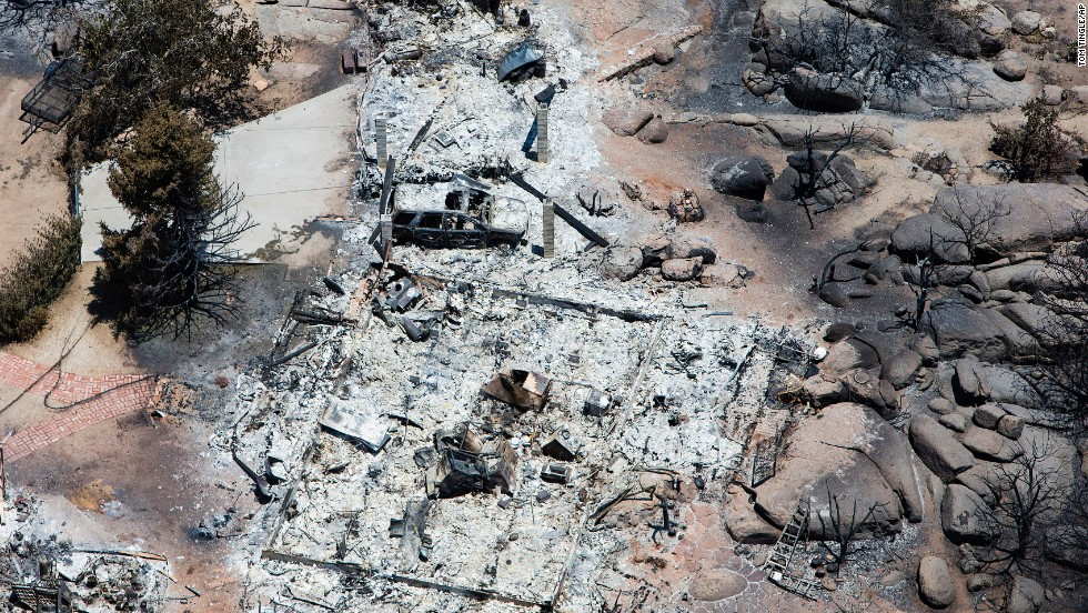 An aerial overview shows the devastation in Yarnell on July 3. Crews have begun making progress on the wildfire, which reportedly was 80% contained by Thursday night, July 4.