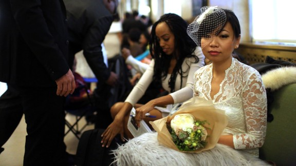 Lini Sasanto waits to fill out marriage papers at a busy City Clerk's office on December 12, 2012, in New York.