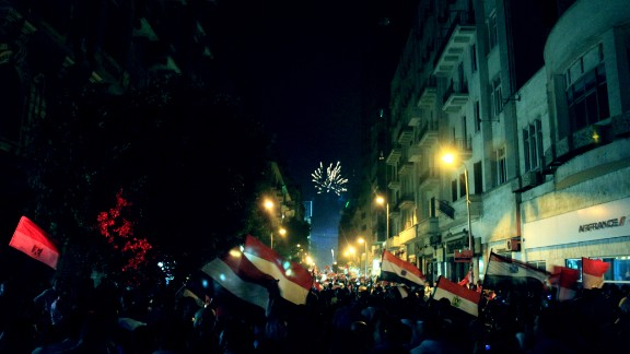 """Fireworks and flags filled the sky as anti-Morsy protesters celebrated the toppling of Morsy in this image taken July 3 by <a href=""""http://ireport.cnn.com/docs/DOC-999917"""">Norman Halim</a>, who said he was concerned about what could happen next."""