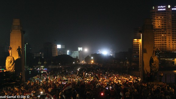 """iReporter <a href=""""http://ireport.cnn.com/docs/DOC-999679"""">Mahmoud Gamal</a> captured this image of crowds in Cairo on Wednesday, July 3, after news came Mohamed Morsy, the former Egyptian president, had been ousted. """"It was an amazing carnival,"""" he said."""