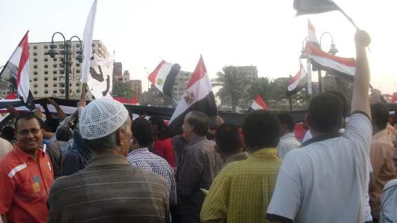 """Flags were ubiquitous throughout the protests, such as in this crowd in Cairo on Tuesday, July 2. """"A lot of my family [are] religious, so they pray that there will be peace in Egypt,"""" said <a href=""""http://ireport.cnn.com/docs/DOC-999156"""">Charves</a>."""