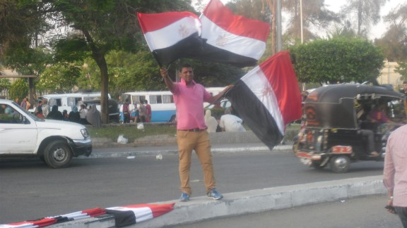 """Freelance journalist <a href=""""http://ireport.cnn.com/docs/DOC-999156"""">Erica Charves</a> captured this street scene July 2 as protests against Morsy gathered momentum."""