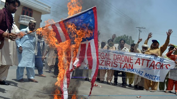Pakistani anti-drone protesters from the United Citizen Action torch a U.S. flag in Multan on May 30, 2013.