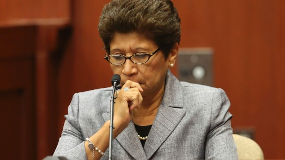 George Zimmerman's mother, Gladys Zimmerman, listens to the 911 tape while taking the stand during his trial in Seminole County circuit court on July 5.