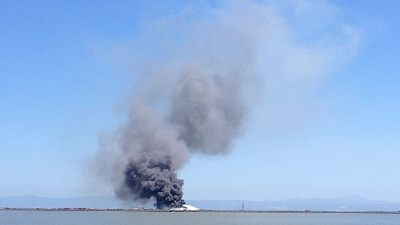 Smoke rises from the crash site across the San Francisco Bay on July 6.