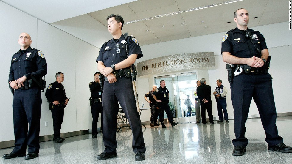 Police guard the Reflection Room at the San Francisco airport's international terminal, where passengers from Asiana Airlines Flight 214 were reportedly gathering after the crash landing on July 6.