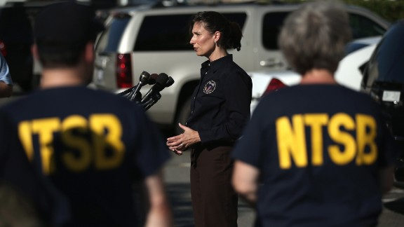 Deborah Hersman, chairwoman of the National Transportation Safety Board, speaks to the press at Reagan National Airport in Arlington, Virginia, before departing for San Francisco with an NTSB crew on July 6 to investigate the crash site.