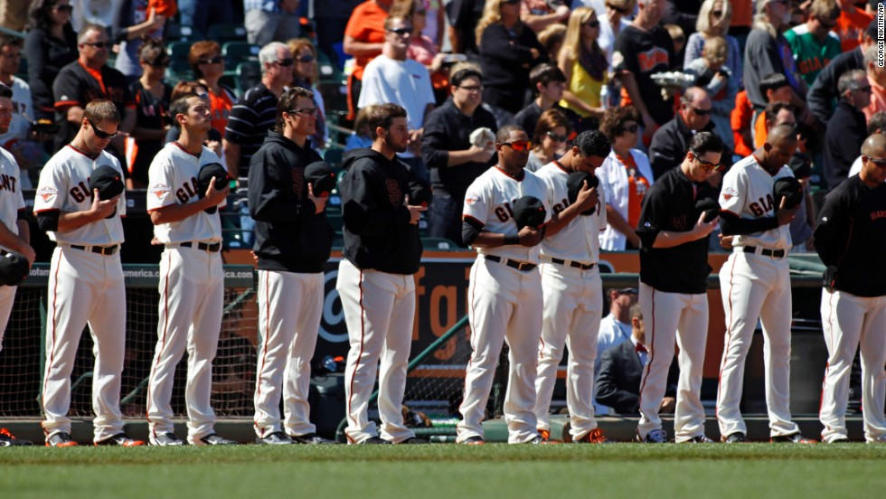 The San Francisco Giants observe a moment of silence for those killed and hurt in the crash before their baseball game on July 6 against the Los Angeles Dodgers at AT&T Park in San Francisco.