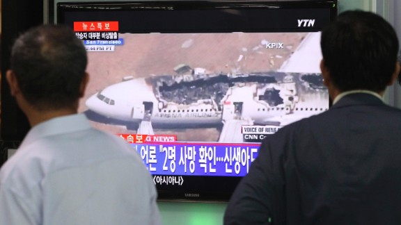 People in Seoul watch a news program reporting about the crash landing on July 6 in San Francisco. Asiana Airlines Flight 214 took off from Seoul earlier Saturday.