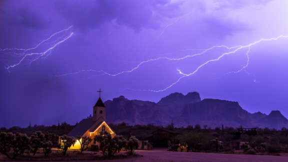 "Storm chaser Stacy LeClair got this shot during a severe storm that swept through Apache Junction, Arizona, on July 7. ""The Superstition Mountains are a favorite landmark in Arizona, and the church offered a unique background for showing how powerful nature can be,"" she said."