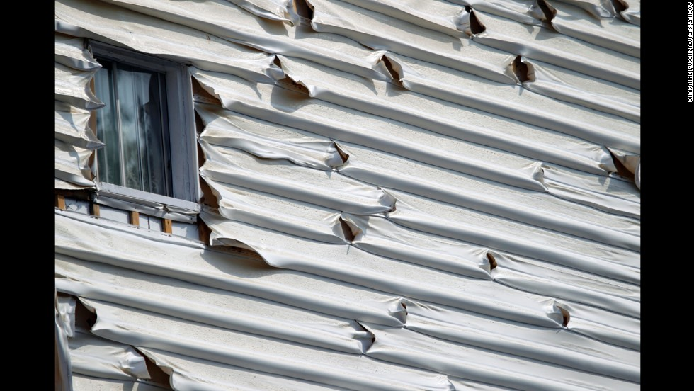Melted siding on a home is seen near the scene of a train derailment in Lac Megantic, Quebec, July 7.