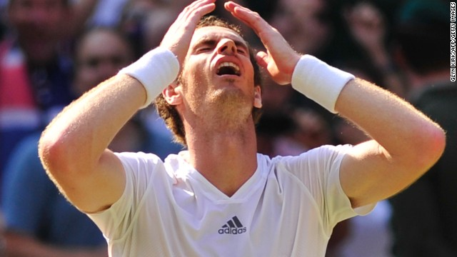 Britain's Andy Murray celebrates beating Serbia's Novak Djokovic during the men's singles final on day thirteen of the 2013 Wimbledon Championships tennis tournament at the All England Club in Wimbledon, southwest London, on July 7, 2013.