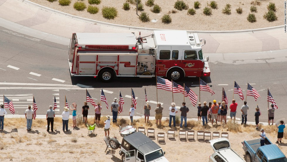 A fire truck travels as part of the procession under escort by the Joint Arizona Honor Guard.