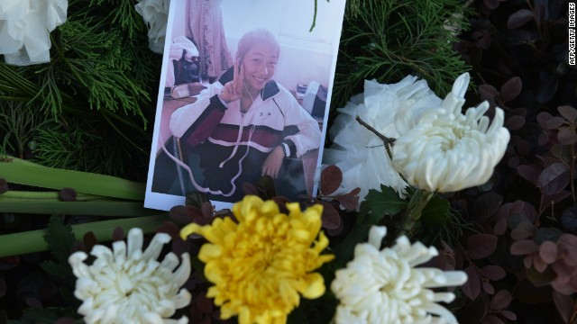 A photograph of 17-year-old Wang Linjia is placed among flowers outside her high school in Jiangshan in China's eastern Zhejiang province on July 8, 2013.