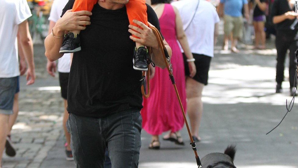 Orlando Bloom takes a Sunday stroll with his son Flynn and the family dog on July 7.