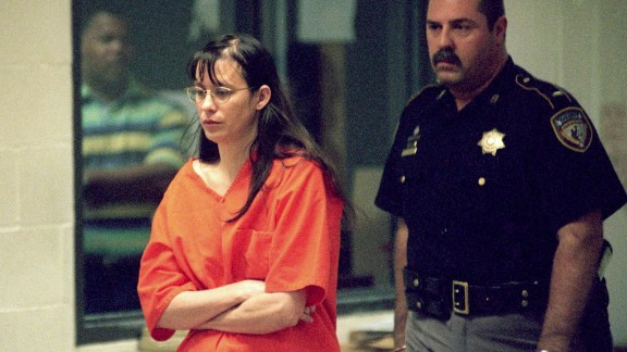 """Yates is escorted into court on June 22, 2001, in Houston. Her trial began on February 18, 2002. The prosecution's expert witness, psychiatrist Park Dietz, testified that Yates got the idea to drown her children from an episode of """"Law & Order."""" However, the show's producers later said that no such episode aired."""