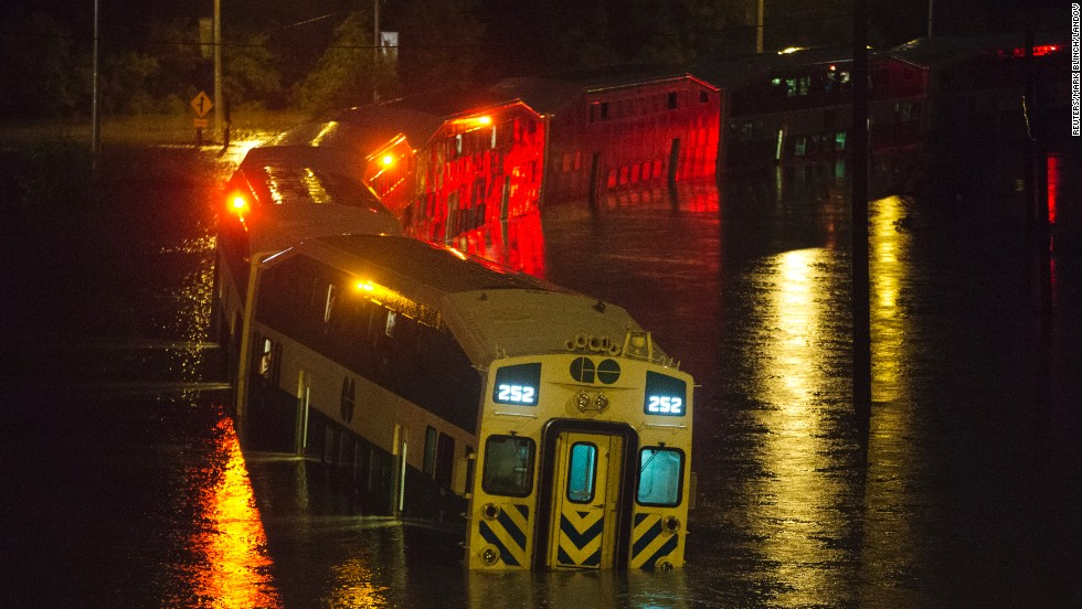 The flooding also disrupts rail traffic, stranding commuters on the Go Transit train on July 8. Nearly 4 inches fell in the heart of the city, according to Canadian sources.