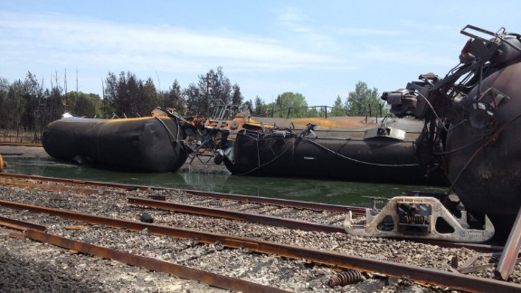 Derailed rail cars sit in mud and oil in Lac-Megantic on July 8, in this handout image released by the Transportation Safety Board of Canada.